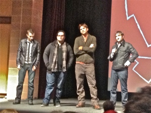 "Ashton Kutcher, with director Joshua Michael Stern (his left), co-star Josh Gad, and writer Matt Whiteley (tie) at Sundance premiere of ""Jobs"""