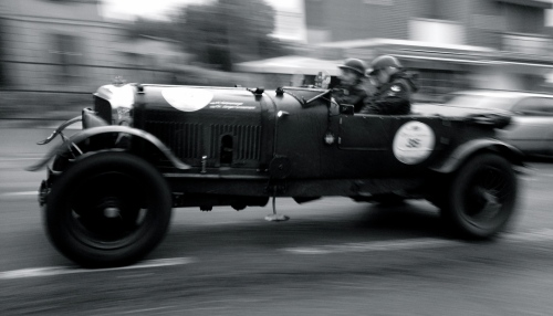 Germans Jurgen Grossman and Herbert Gronemeyer wrestle their 1927 Bentley through Moglia, during the 2013 Mille Miglia.