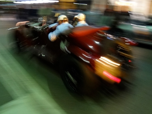 A Mille Miglia competitor speeds away from the start line in Brescia. (Jerry Garrett Photo)
