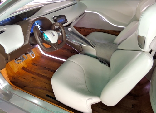 The interior of Pininfarina's Cambiano concept car is infused with briccole oak.