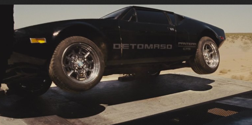 A De Tomaso Pantera gets ready for a rough unload from a train (Fast Five)