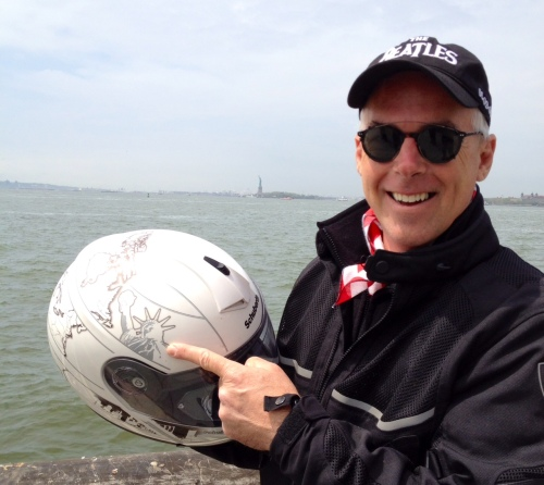 Don Emde, organizer of the Cannon Ball Baker Centennial ride, poses with Lady Liberty in NYC. (Ty Van Hooydonk photo)