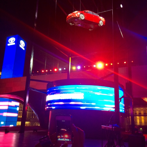 The 2016 Toyota Prius is lifted high in the air, at its debut in Las Vegas on Sept, 8. Why? (Jerry Garrett Photo)